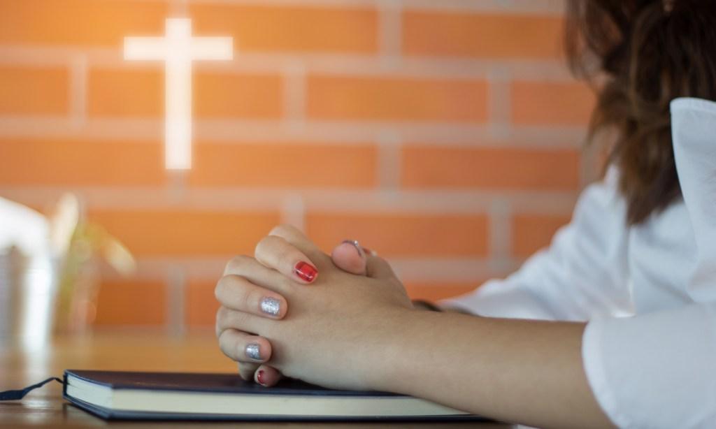Young evangelical praying