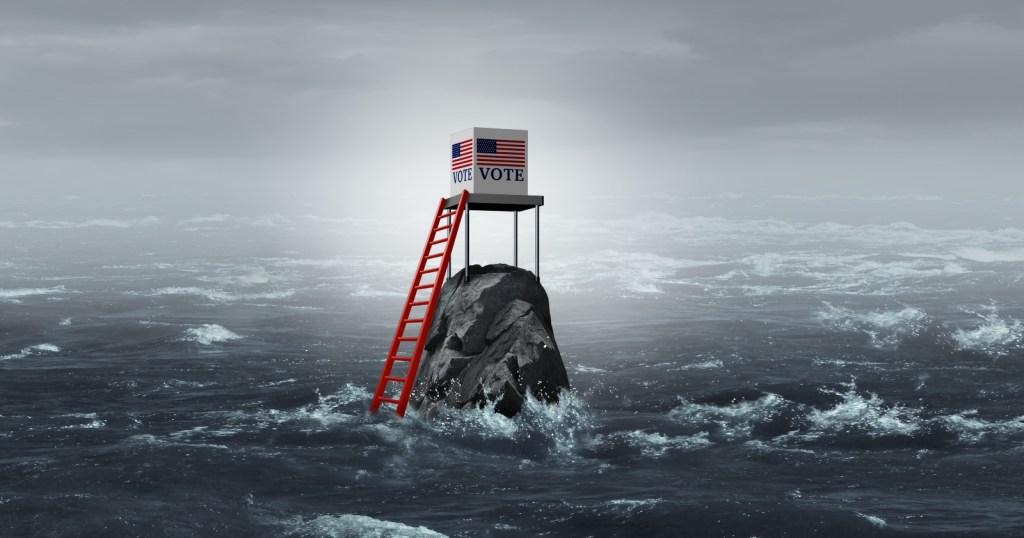 Voting booth teetering on a rock in the ocean