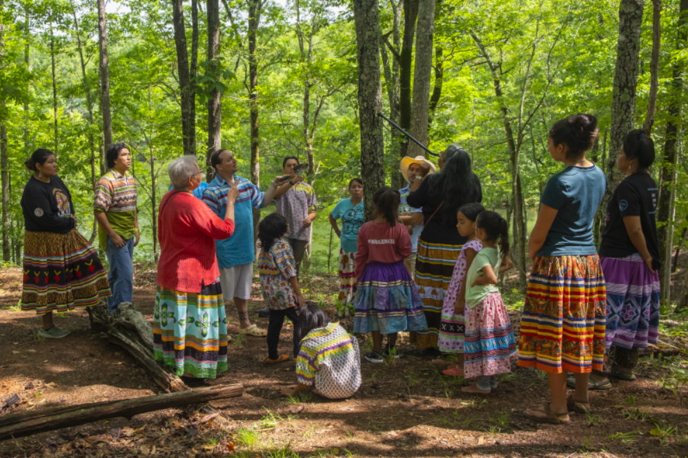 Briggs-Cloud and others identify tree species as part of their language immersion program.