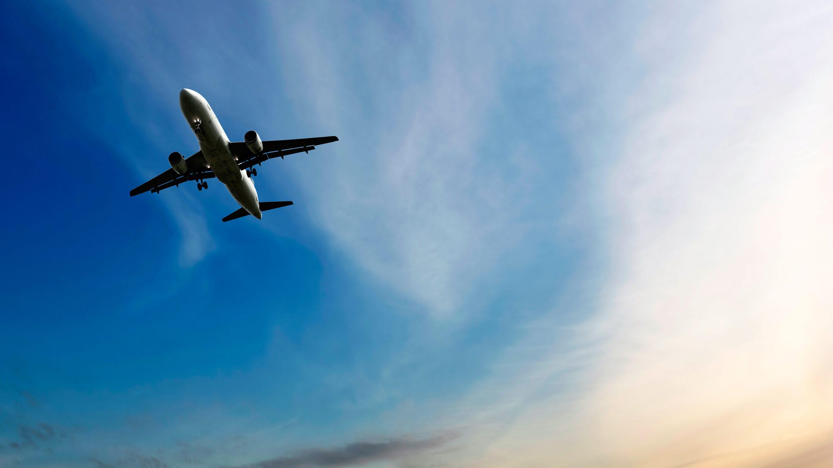 Jet airplane landing at dusk