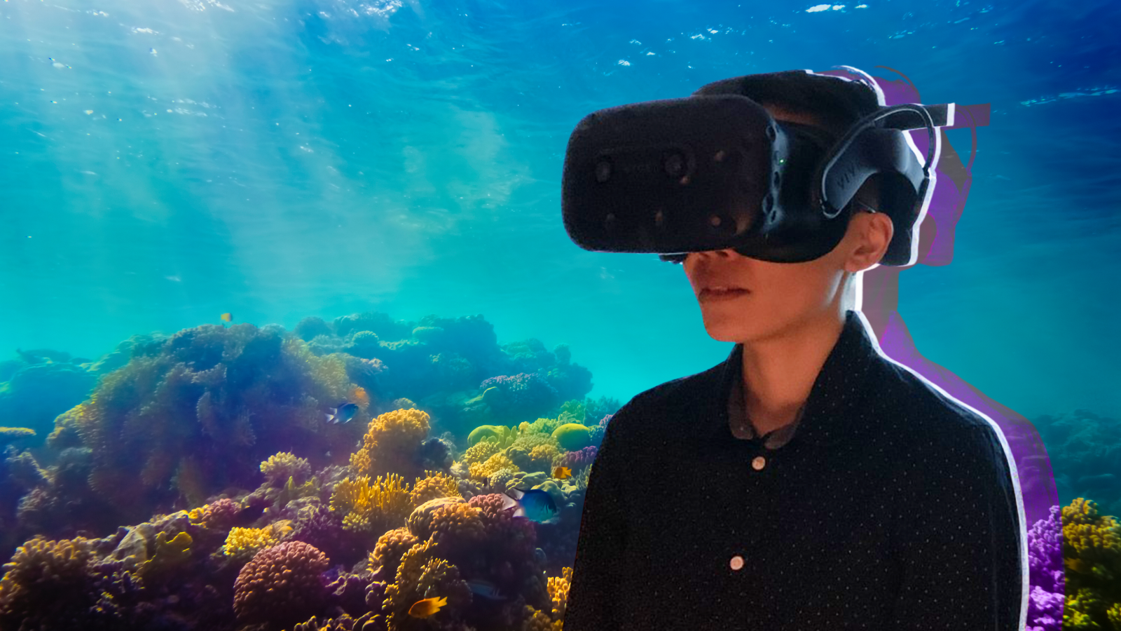 A young student wearing VR goggles, overtop of a coral reef background