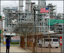 A student snaps a photo of the ExxonMobil refinery.