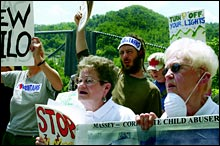 Activists protest peacefully outside a coal-processing plant in West Virginia.