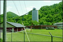 A coal silo looms behind Marsh Fork Elementary School.