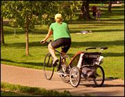 Biking with a kid trailer. Photo: iStockphoto
