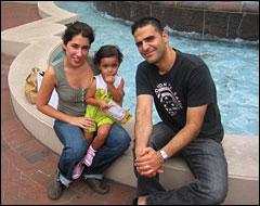 Sarah and  Peter Shojaie and their daughter