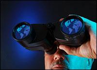 Looking through binoculars.