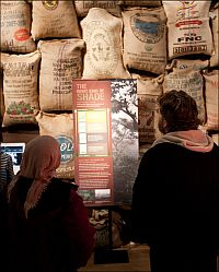 visitors looking at shade-grown coffee display