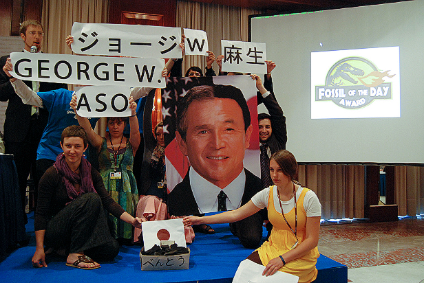 Protesting Japan's emissions reduction plan.
