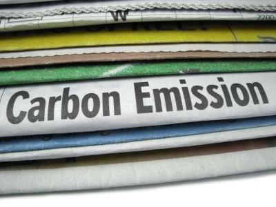 "newspaper with ""carbon emission"" headline"