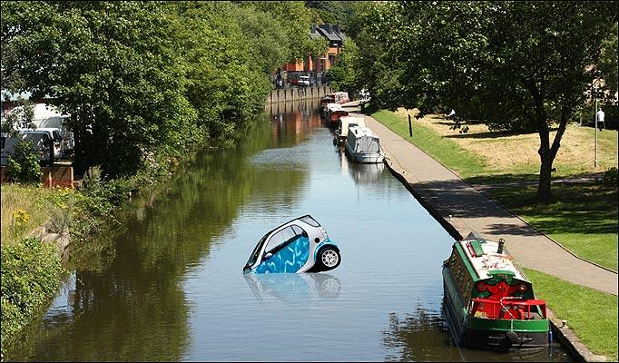 Smart car in Dutch canal