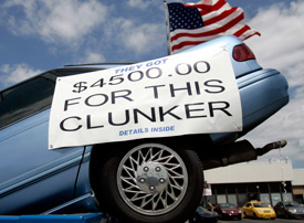 A vehicle sits in a dumpster on display in front of Bill Wink Chevrolet dealership to attract customers in for the Cash For Clunkers program in Dearborn, Michigan August 6, 2009. (Rebecca Cook / Reuters)