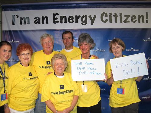 Women in front of Energy Citizen banner.