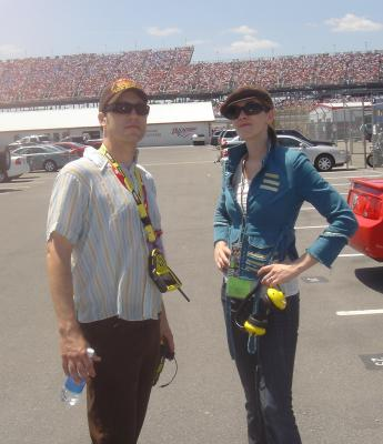 Little and her NASCAR-savvy guide in front of the grandstands.