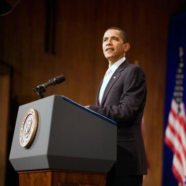 Obama at podium.