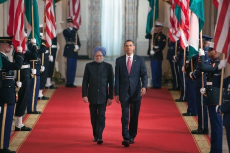 President Barack Obama and Prime Minister Singh of India walk along the Cross Hall of the White House towards the East Room for the arrival ceremony.