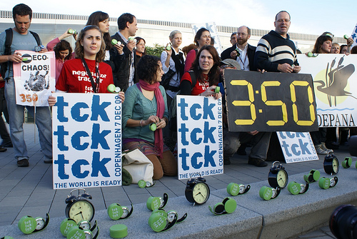 protestors with clocks