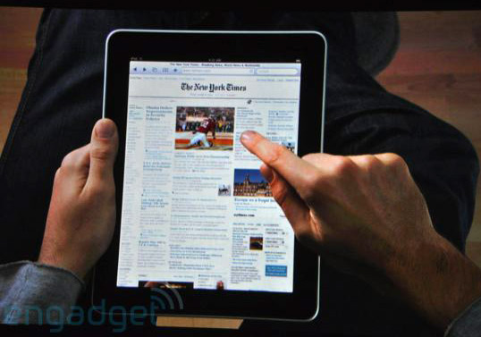 iPad in lap with New York Times on screen