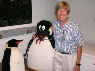 Dr. Boersma with stuffed animal penguins