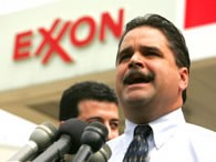 Richard Pombo and an Exxon sign
