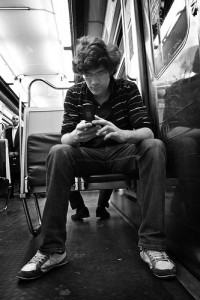 guy texting on subway