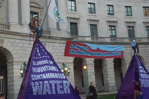 Protesters locked themselves to 20-foot purple mountains outside the EPA.
