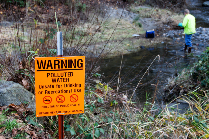 Pullted creek with sign