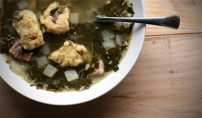 Collard greens, pork stock, and corn dumplings soak in the rich broth of history.