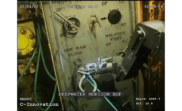 oil spill robotic arm