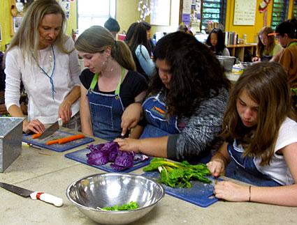 Kids prep vegetables
