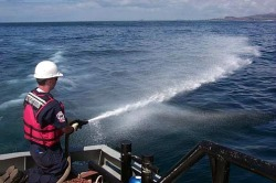 A worker spraying Corexit in the gulf.