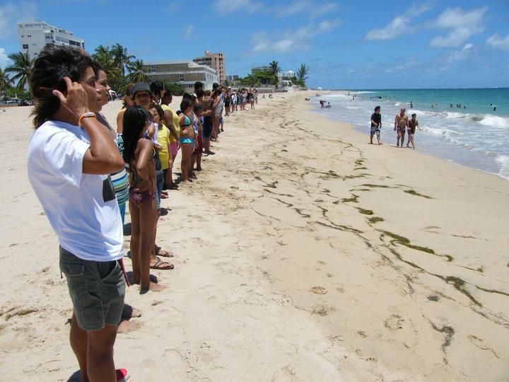 Hands across a beach.