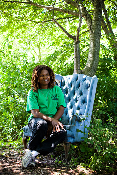 Woman in chair under tree
