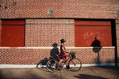 Girl on bike with produce