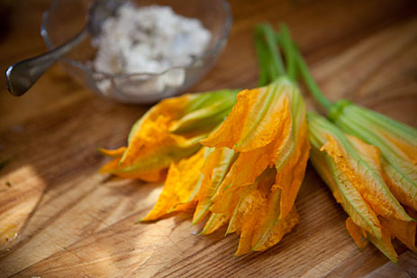 Squash blossoms on cutting board