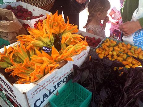 Squash blossoms at market