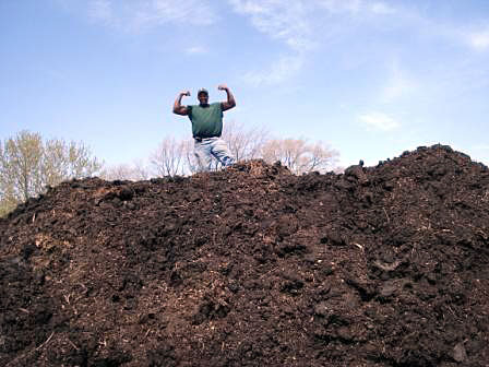 Will Allen on a compost pile