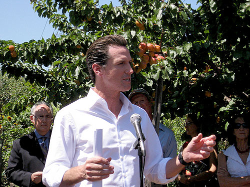 Mayor Gavin Newsom in front of trees