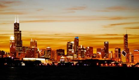 City skyline against orange sky