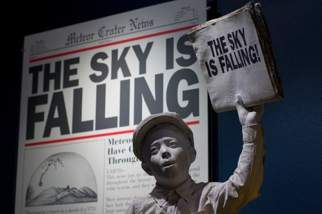 """boy holding """"sky is falling"""" sign"""
