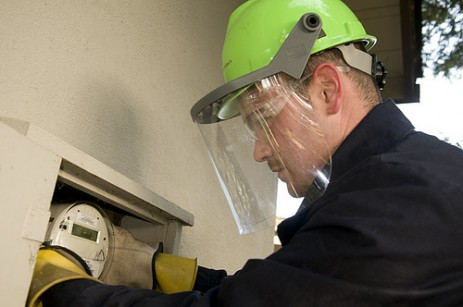 Worker installing a smart meter.