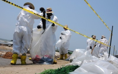Oil spill cleanup workers.