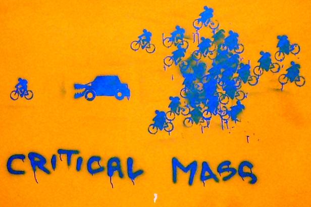 Critical Mass bikes chasing car-eating bike