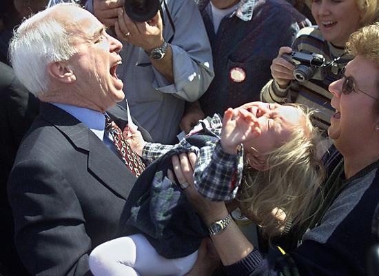 John McCain prepares to eat a child