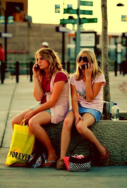 teen girls talking on cell phones