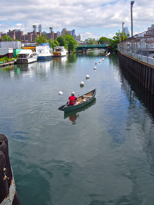Paddling a canoe on the Gowanus Canal.