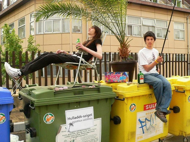 teens relaxing on recycling bin paradise