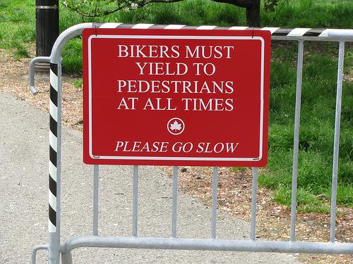 Bikers must yield to pedestrians sign