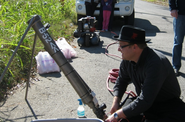Tommy Wilson of Bomb the Blight with seed bomb cannon