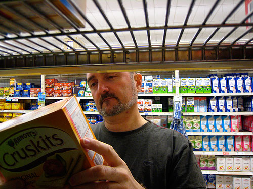 Man reading grocery label